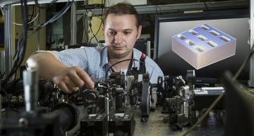 Physicist Sergey Kruk works on a diagram of the metamaterial structure. (Credit: Stuart Hay, ANU)