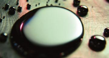 Thermal interface materials combine liquid metal with a solid metal preform