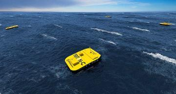 Using ocean wave energy to recharge underwater vehicles