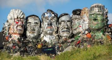 G7 campaigners use e-waste to build 'Mount Rushmore' in Cornwall