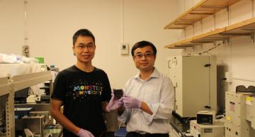 Dr. Zonghao Liu (left) and Professor Yabing Qi (right) with the 5 cm × 5 cm perovskite solar module that they developed in their lab at OIST. Credit: OIST