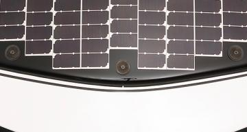 Toyota is working with NEDO and Sharp are starting public trialsof an electric vehicle using a new generation of high efficiency solar cells to boost the range.