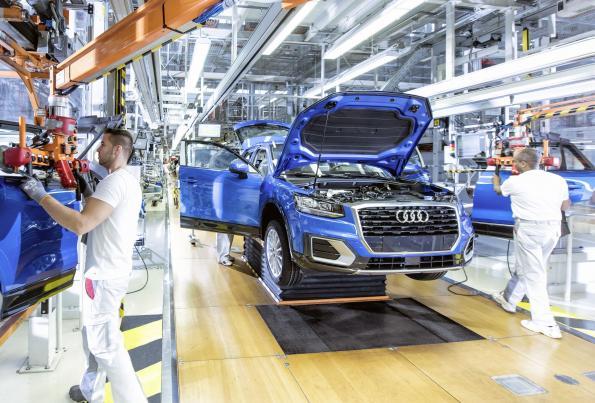 Audi cuts production jobs, hires digital experts