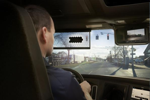 Sun visor with controllable transparency prevents glare