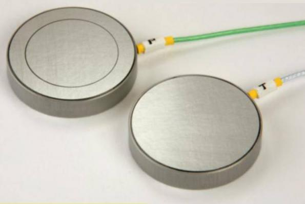 Capacitance micrometry detects atomic scale displacements