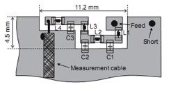 Capacitors can reduce size and improve efficiency of cellular handset antennas