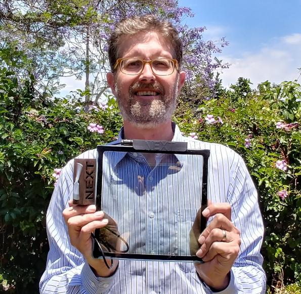 """NEXT CTO, Corey Hoven holds an 8""""x 8"""" functional prototype."""