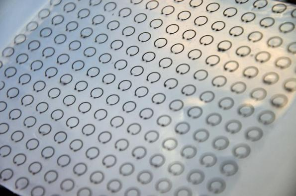 Stretchable skin cloaks objects by trapping radar waves