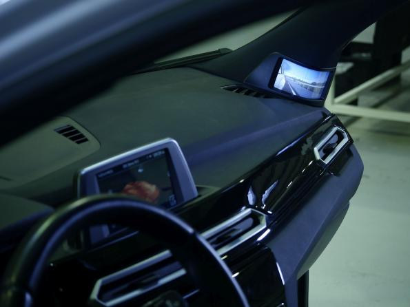 Demo car sports flexible rear view screen and LED-lit smart roof bars