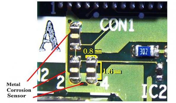 Metal corrosion sensor fits on printed circuit boards
