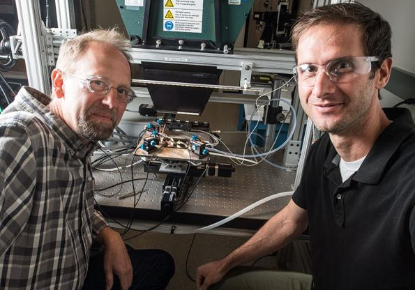 NREL researchers Ryan France (left) and John Geisz fabricated a solar cell that is nearly 50% efficient. Photo by Dennis Schroeder, NREL