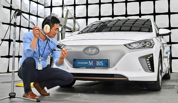 EV front grill cover generates artificial engine sound