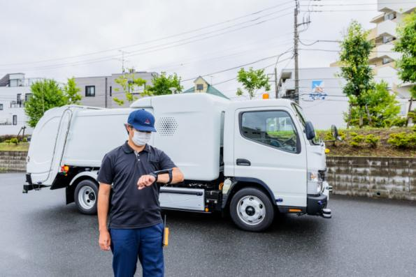 The eCanter SensorCollect concept refuse truck from Daimler subsidiary FUSO can be remotely controlled by operators walking alongside