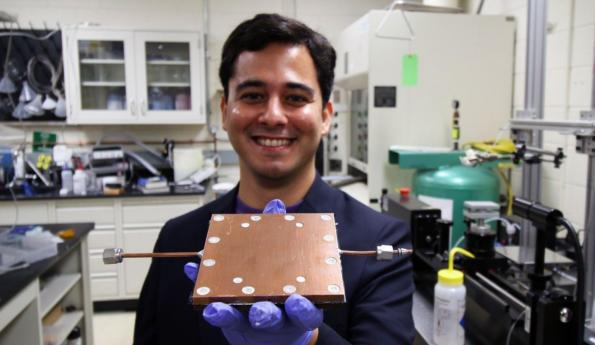LAB MEMBER MOJTABA EDALATPOUR SHOWS THE THERMAL DIODE DEVELOPED BY BOREYKO'S TEAM.