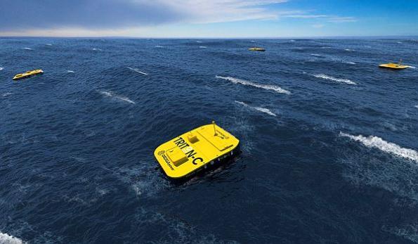 Using ocean wave energy to recharge underwater vehicles
