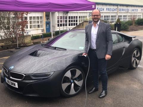 Adam Bond, AFC Energy CEO, charges BMW i8 with world's first fuel cell EV charging system at event in Dunsfold Park, Surrey