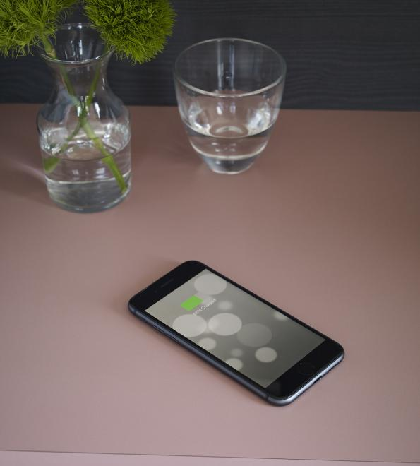 Formica's Intentek Wireless Charging Surface is a laminate surface with integrated charging coils that can wirelessly charge Qi Certified devices