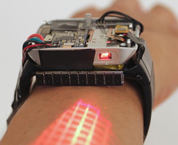 Smart watch expands touch display to the skin