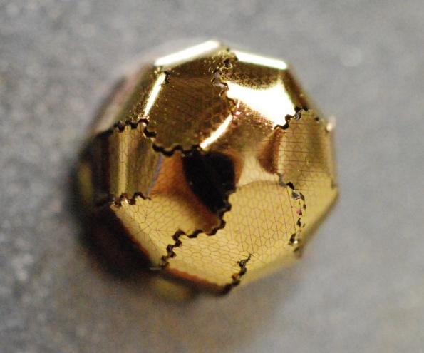 Origami technique turns flat optical sensors into hemispherical eyes