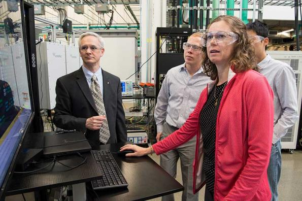 NREL researchers Annabelle Pratt, Chin-Yao Chang, Bri-Mathias Hodge, and Benjamin Kroposki collaborate in the Power Systems Energy Center in the Energy Systems Integration Facility (ESIF) at NREL working on AEG .