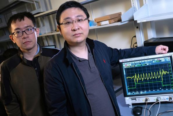 Rice University graduate student Yan He, left, and Kaiyuan Yang, an assistant professor of electrical and computer engineering, will demonstrate their enhanced security strategy for the IoT (Credit: Jeff Fitlow/Rice University)