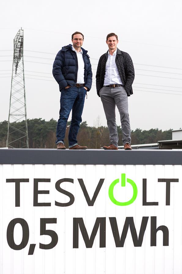 Daniel Hannemann (left), Commercial Director, and Simon Schandert, Technical Director at TESVOLT standing on the power storage container