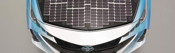 Toyota is working with NEDO and Sharp are starting public trials of an electric vehicle using a new generation of high efficiency solar cells to boost the range.