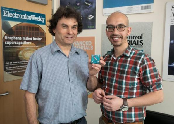 Richard Kaner and Maher El-Kady in Kaner's office. Kaner is holding a replica of a new energy storage and conversion device they developed.